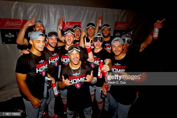 The St. Louis Cardinals celebrate in the locker room after their 13-1 win over the Atlanta Braves in game five of the National League Division Series...