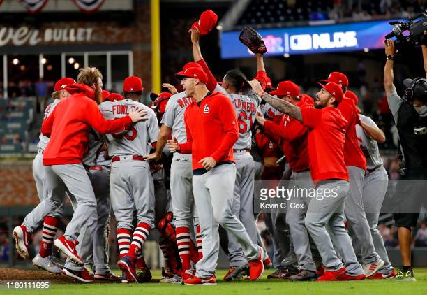 The St. Louis Cardinals celebrate their 13-1 win over the Atlanta Braves in game five of the National League Division Series at SunTrust Park on...