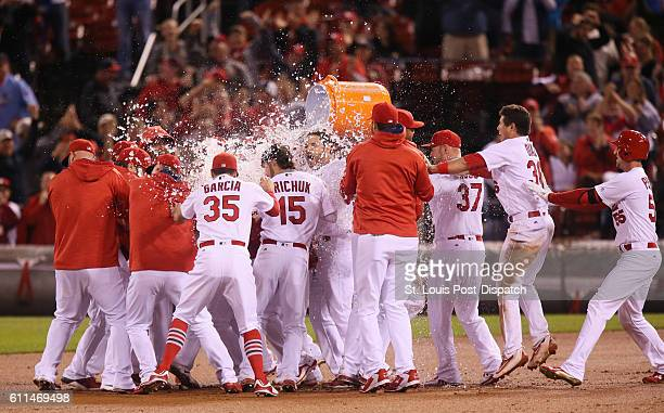 The St Louis Cardinals celebrate with an ice bath after Yadier Molina drove in the gamewinning run with a double in the ninth inning against the...