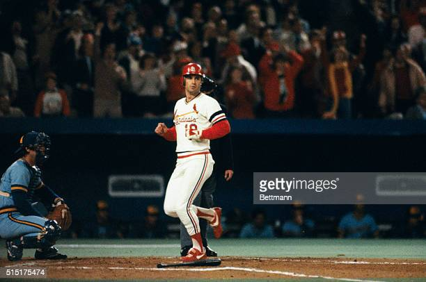 The St Louis Cardinals Dane Iorg scores on a hit by teammate Willie McGee during the second inning of the sixth game of the 1982 World Series against...