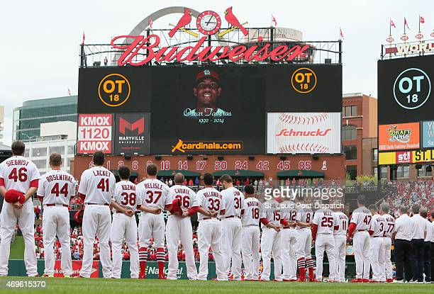 The St Louis Cardinals line the base paths for a video tribute that was played in honor of former outfielder Oscar Taveras during pregame ceremonies...
