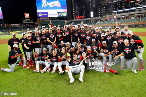 The St. Louis Cardinals pose for a team photo as they celebrate their 13-1 win over the Atlanta Braves in game five of the National League Division...