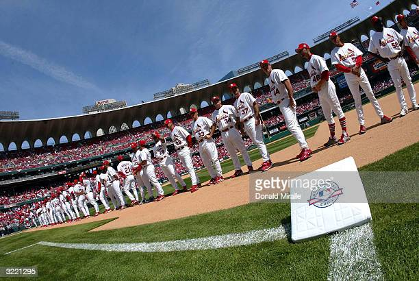 The St Louis Cardinals stand on the field for introductions before the start of the Milwuakee Brewers v St Louis Cardinals Opening Game Day at Busch...