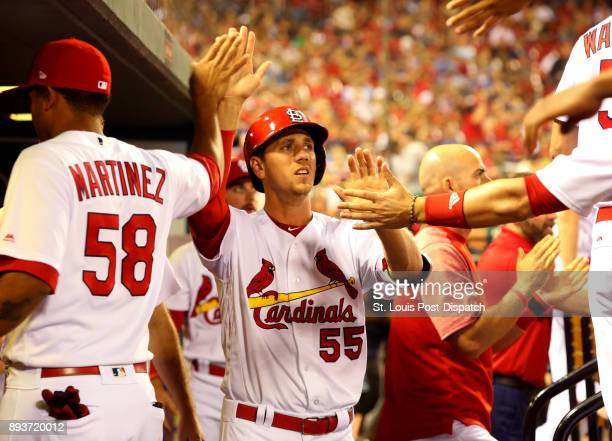 The St Louis Cardinals' Stephen Piscotty is congratulated by teammates after hitting an RBI double and scoring against the Toronto Blue Jays on April...