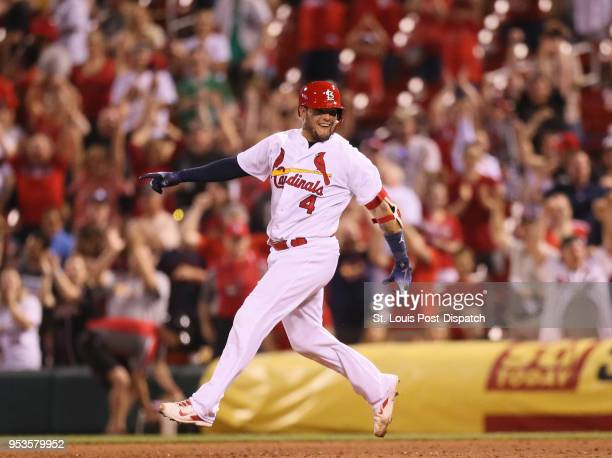 The St Louis Cardinals' Yadier Molina reacts as he rounds first base after driving in the gamewinning run with a single in the ninth inning against...