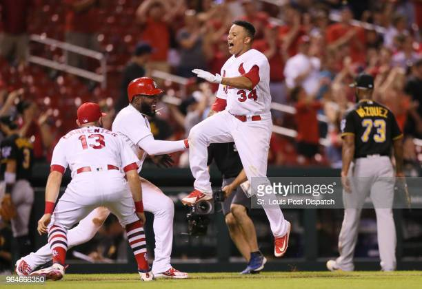 The St Louis Cardinals' Yairo Munoz is greeted by teammates including Marcell Ozuna second from left and Matt Carpenter at home plate after he hit a...