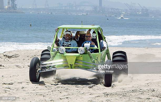 The St. Lunatics, featuring Nelly , arrive by dune buggy at MTV's TRL Beach House: Summer on the Run on May 31, 2004 in Long Beach California.