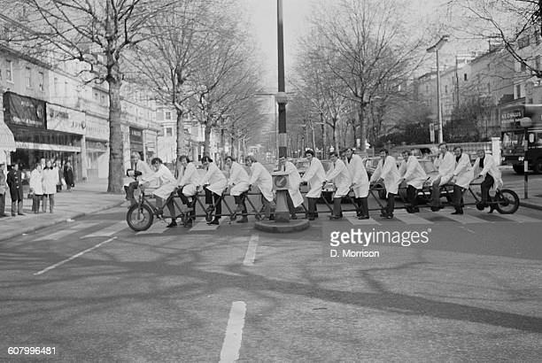 The St Mary's Hospital rugby team in training for the hospital's cup final on a 14seater bicycle London UK 2nd March 1971