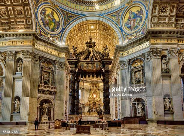 The St. Peter's basilica is seen from inside on November 1, 2017 in Vatican City, Vatican. Thousands of people visit every day the largest christian...