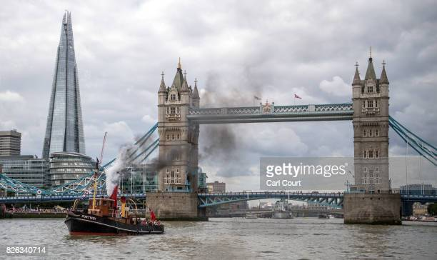 The ST Portwey passes The Shard and Tower Bridge as she pulls away from HMS President the Royal Navy's permanent shore establishment in London on...