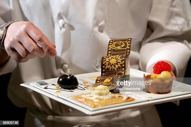 The St Regis Executive Chef Richard Brown explains the dessert plate of frozen nougat dark chocolate dome crisp apple tart with vanilla ice cream...