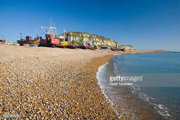 the stade pebble beach with fishing fleet on shore. - hastings stock photos and pictures