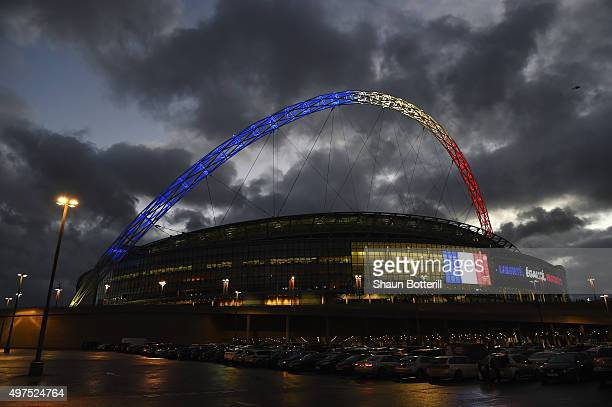 The stadium arch is lit up with the colours of the French flag before the International Friendly match between England and France at Wembley Stadium...