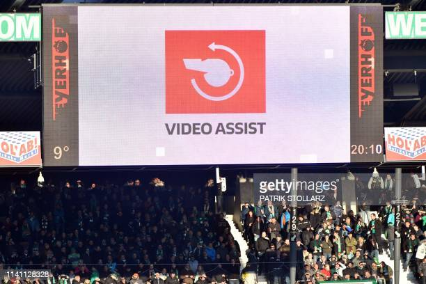 The stadium display shows that the VAR video assistant is being checked during the German first division Bundesliga football match Werder Bremen v...