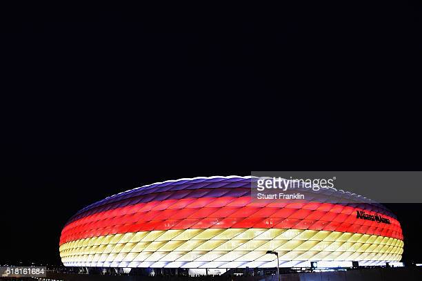 The stadium is illuminated in the colours of the German flag during the International Friendly match between Germany and Italy at Allianz Arena on...