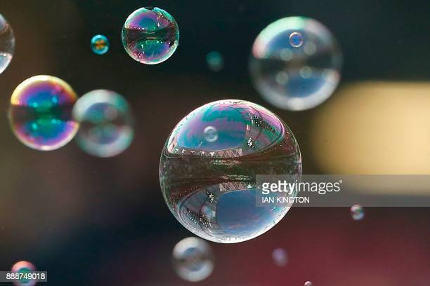 The stadium is reflected in bubbles seen ahead of the English Premier League football match between West Ham United and Chelsea at The London Stadium...