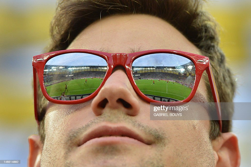 a0d70f74e4f The stadium is reflected in the sunglasses of a football fan ahead ...