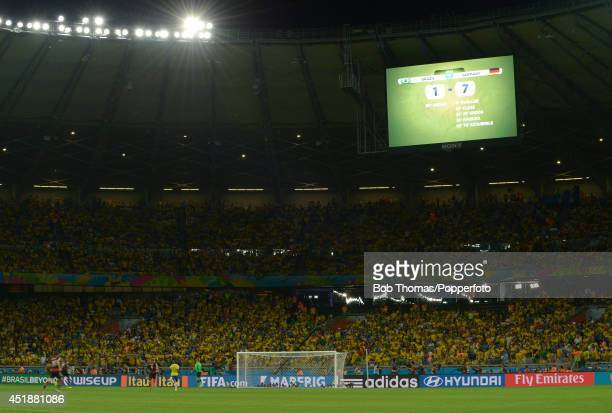 The stadium scoreboard showing the 71 scoreline during the 2014 FIFA World Cup Brazil Semi Final match between Brazil and Germany at Estadio Mineirao...