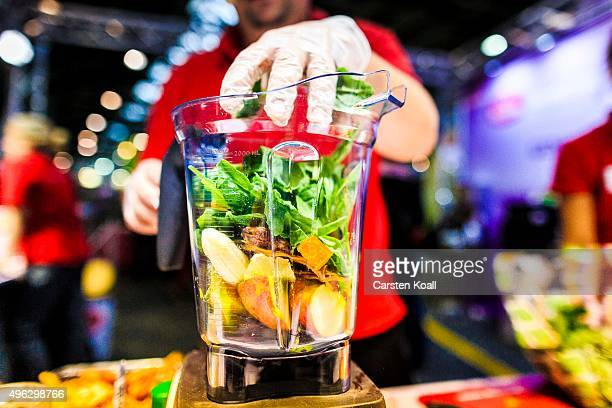 The staff at a stand of the Keimling Naturkost GmbH fills a mixer with vegetables and fruits during a demonstration at the Veggie World 2015 Vegan...