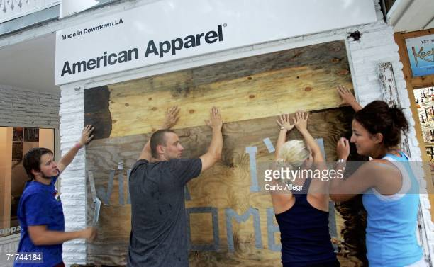 The staff of American Apparel board up their windows with plywood in advance of Tropical Storm Ernesto August 29 2006 in Key West Florida Ernesto has...