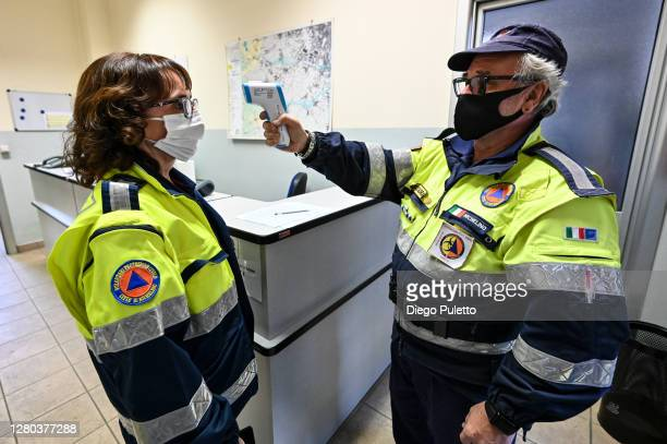 The staff of civil protection measures body temperature before the work shift on October 15 2020 in Turin Italy The Emergency Piedmont Civil...
