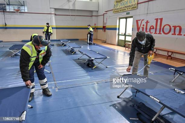 The staff of civil protection prepare the beds for the field hospital for possible COVID19 patients on October 15 2020 in Turin Italy The Emergency...
