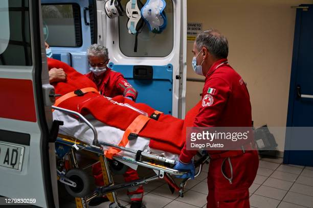The staff of the red cross during the transport of a patient to the emergency room in the Mauriziano hospital on October 12 2020 in Turin Italy The...
