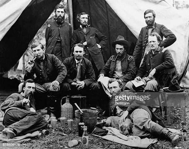 The staff of Union General Andrew Porter lounge in front of a tent during the Civil War