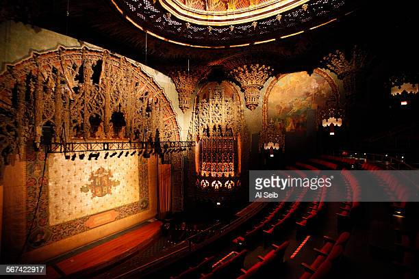 The stage curtain and elaborate proscenium arch surrounding the stage opening and ceiling of the United Artists Theater in the Ace Hotel Hotel and...