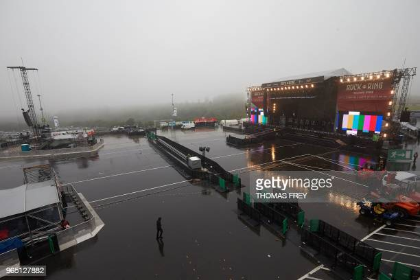 The stage for the 'Rock am Ring' music festival stands in pouring rain prior to the festival's opening on June 1 2018 in Nuerburg western Germany /...