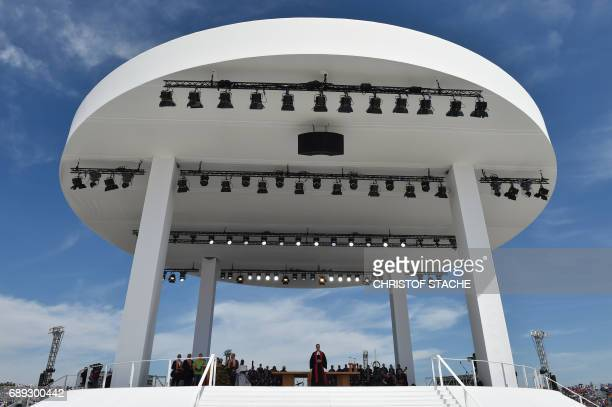 The stage of the final mass of the Kirchentag festival celebrating the 500th anniversary of the Reformation is pictured at a meadow near the river...