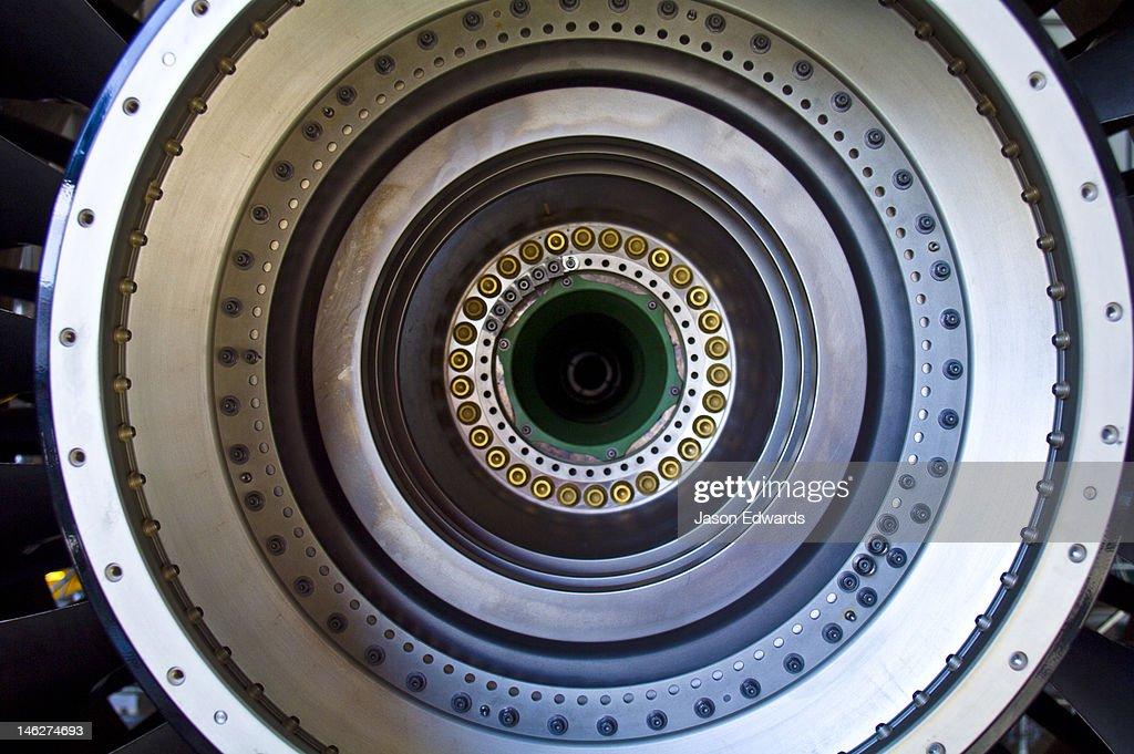 The stainless steel spinning shaft of a jet airliner turbofan engine. : Bildbanksbilder