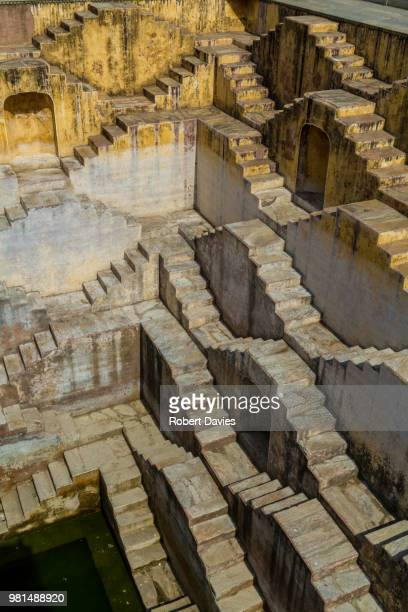 the staircase at chand baori in jaipur, india. - abhaneri stock photos and pictures