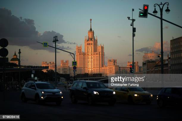 The Stalinist Kotelnicheskaya Embankment Building is illuminated by the setting sun as Moscovites make their way home on June 20 2018 in Moscow...