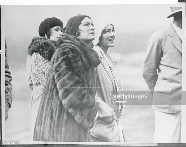 The stamp of approval is read on countenance of Mrs Charles Lindbergh as she watches her famous flyer husband in glider flight at Carmel California...