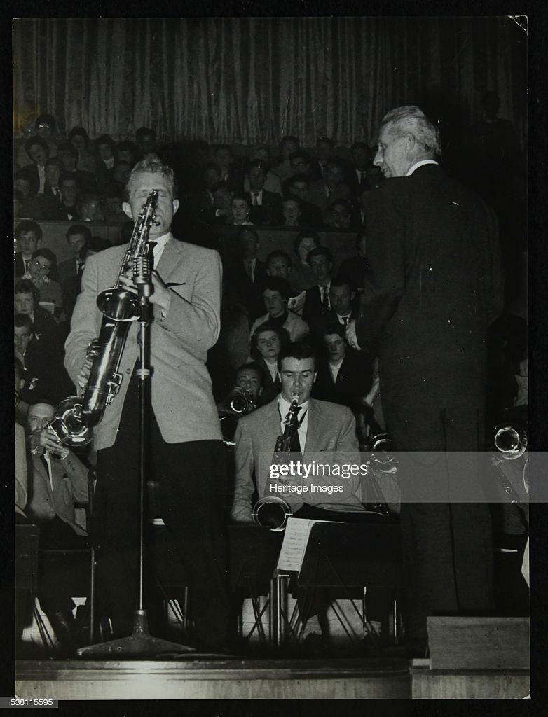 The Stan Kenton Orchestra in concert, 1956. Tenor saxophonists Bill Perkins and Tommy Whittle and bandleader Stan Kenton. Artist: Denis Williams.