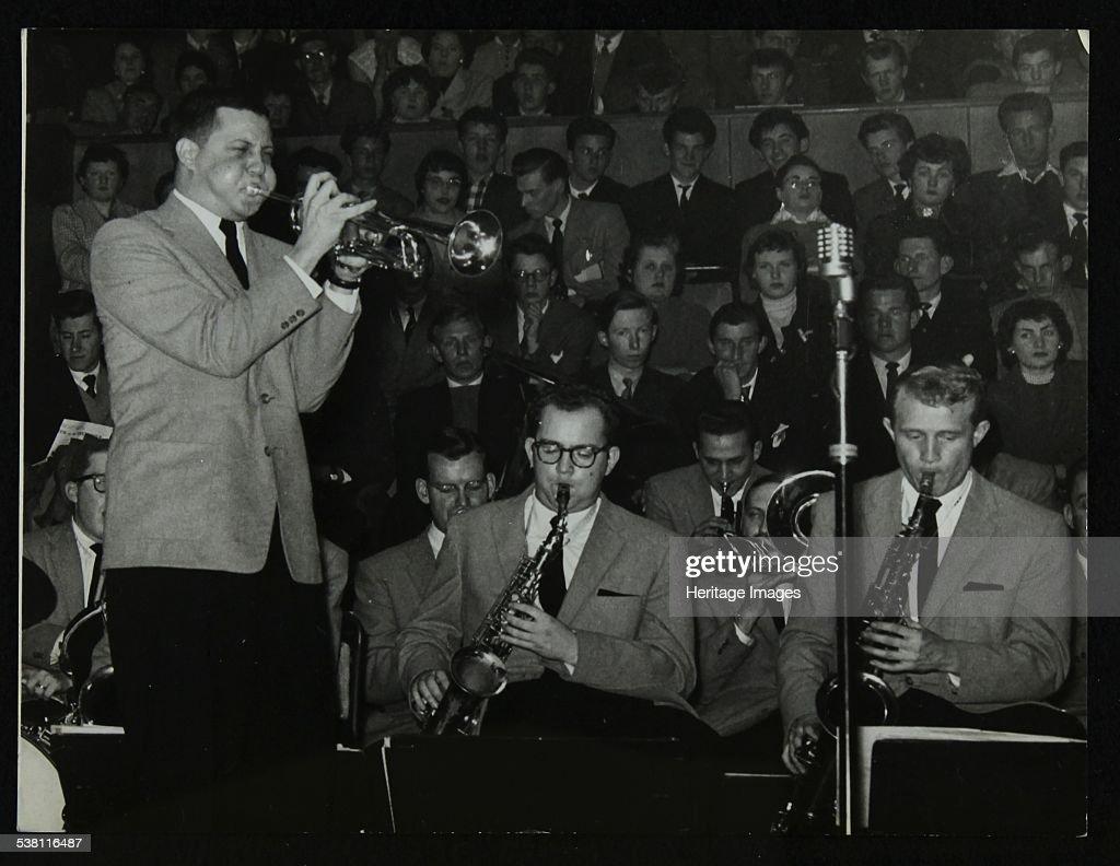 The Stan Kenton Orchestra in concert, 1956. Vinnie Tano (trumpet), Lennie Niehaus (alto saxophone) and Bill Perkins (tenor saxophone). Artist: Denis Williams.