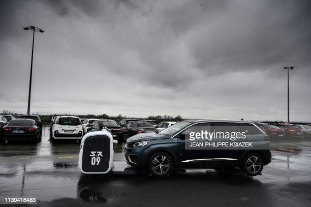 The Stan robot developed by the startup Stanley Robotics tows a car to park it autonomously in an outdoor parking lot during an experiment at the...