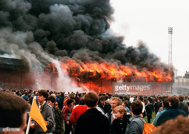 The stand burns while fans look on at Bradford football ground at the Valley Parade Bradford in 1985 | Location Valley Parade Bradford England