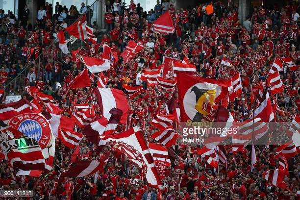 The stand with the supporters of Muenchen is seen as the sun is setting before the DFB Cup final between Bayern Muenchen and Eintracht Frankfurt at...