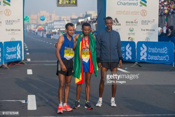 The Standard Chartered Dubai Marathon 2018 men's winners stand for pictures after the race