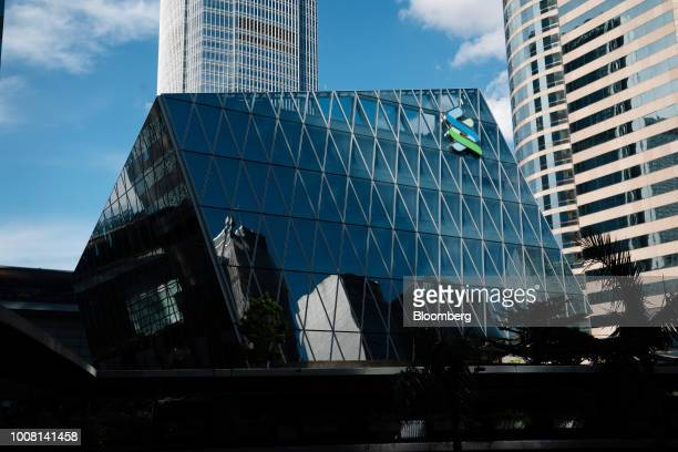 The Standard Chartered Plc logo is displayed atop the Standard Chartered Wealth Management Centre in Hong Kong China on Tuesday July 31 2018 Standard...