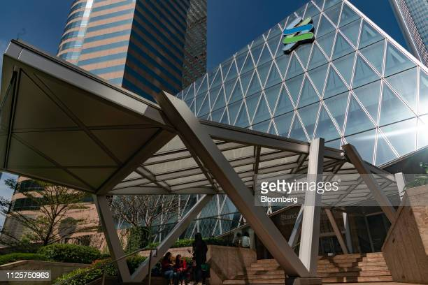 The Standard Chartered Plc logo is displayed atop the Standard Chartered Wealth Management Centre in Hong Kong China on Saturday Feb 16 2019 Standard...