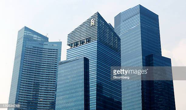 The Standard Chartered Plc logo is displayed atop Tower 1 of the Marina Bay Financial Centre as it stands with other towers of the development in...
