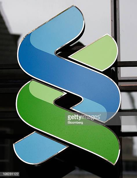 The Standard Chartered Plc logo sits on display at the company's private banking unit in London UK on Wednesday Oct 13 2010 Standard Chartered Plc...