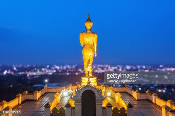 the standing golden buddha, phrathat khao noi temple, nan - religious celebration stock pictures, royalty-free photos & images