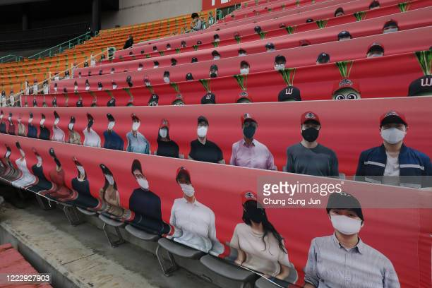 The stands at SK Wyverns club's Happy Dream Ballpark, are filled with placards featuring their fans during the Korean Baseball Organization League...
