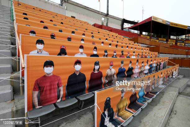 The stands at SK Wyverns club's Happy Dream Ballpark are filled with placards featuring their fans during the Korean Baseball Organization League...
