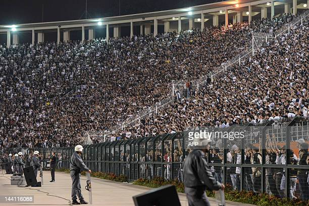 The stands at ther stadium are packed by the supporters of Brazil's Corinthians during Copa Libertadores football match against Ecuador's Emelec at...