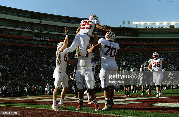 The Stanford Cardinal celebrate a touchdown by running back Tyler Gaffney on a 16-yard run against the Michigan State Spartans in the first quarter...